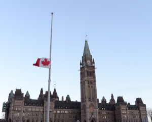 Flags fly at half-mast on Parliament Hill and on the Peace Tower in Ottawa on Thursday.